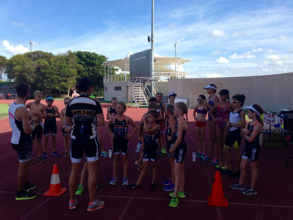 Junior Raptors Being Coached on Running Track