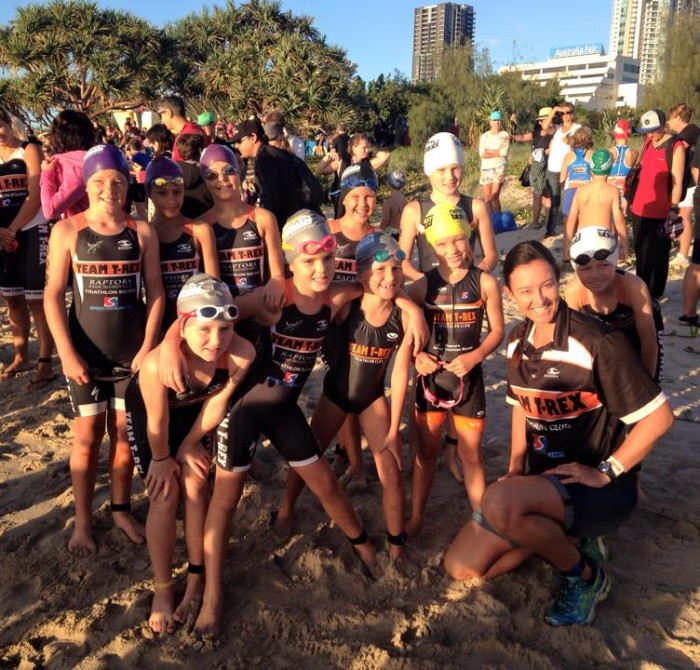 Team T-Rex Junior Raptors smiling on the beach after Triathlon