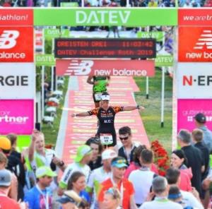 Teresa Theaker Finishing a Triathlon